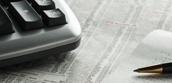 Keyboard, receipt, and a pen on a desk